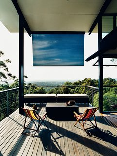 Hillside Family Home in Australia - Photo 2 of 12 - A large deck off the living room overlooks the hills of Noosa and the Pacific Ocean.