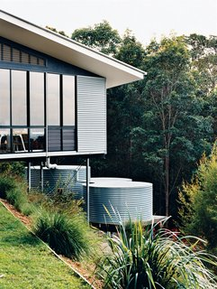 Hillside Family Home in Australia - Photo 7 of 12 - The studio is clad in corrugated tin, echoing the adjacent water-storage tanks, which collect and filter rainwater off the roof.
