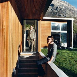When Bronwen Kerr and Pete Ritchie decided to relocate from New Zealand's capital, Wellington, to Queenstown, on the country's South Island, they designed a new home for themselves and their three children on a site Ritchie had purchased when he was living in the area—a stunning lakeside plot. Working in partnership, the couple devised a home and studio that is separated by a passage through the middle of the building.