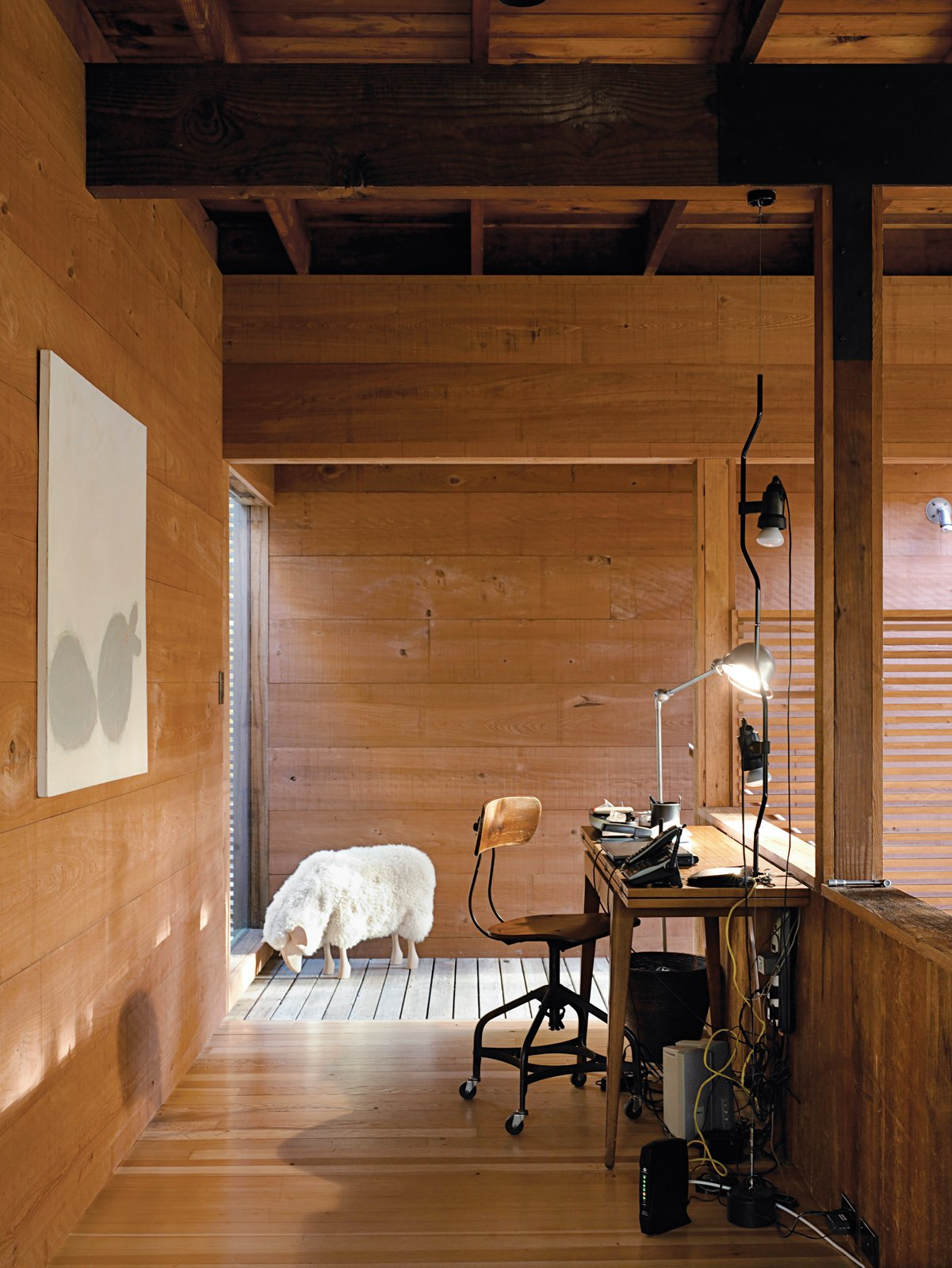 The office space is situated above the loft and is illuminated by Jielde steel lamps from France, which Dolce collects. Tagged: Office, Chair, and Desk.  Photo 12 of 17 in Long Island Summer Home Gets a Modern Addition