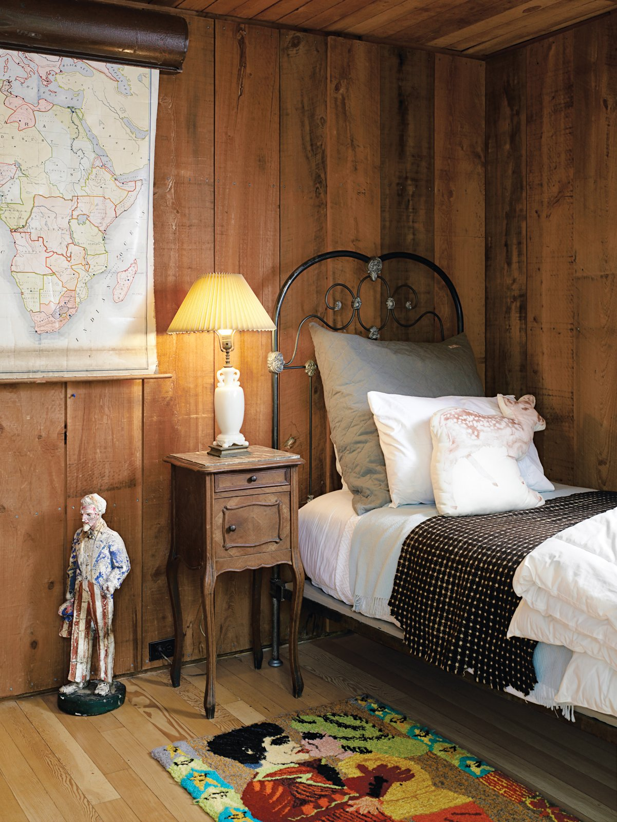 A guest bedroom is furnished in a quaintly quirky fashion. Tagged: Bedroom, Bed, Night Stands, and Table Lighting.  Photo 13 of 17 in Long Island Summer Home Gets a Modern Addition