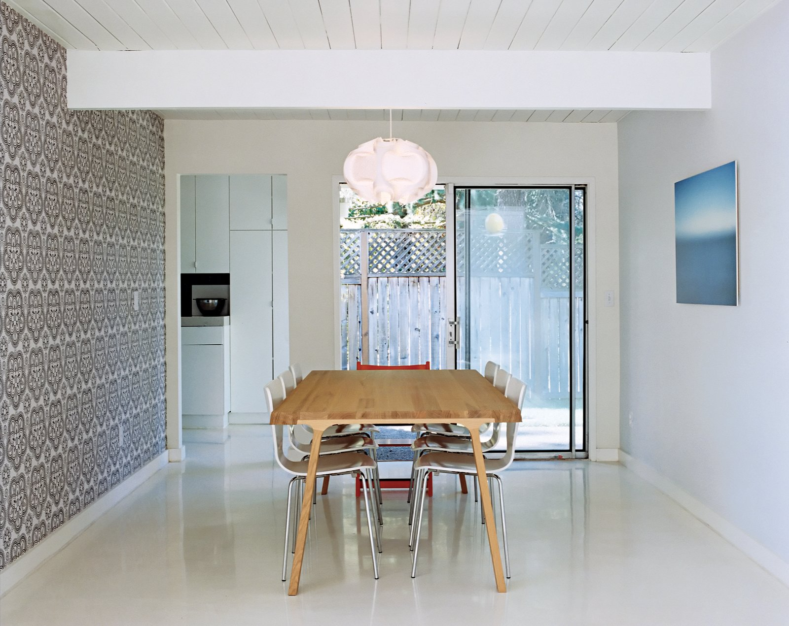 On those rare sunny days the Segerholts might even forsake their Doble dining table by Montis for their green backyard. Tagged: Dining Room, Pendant Lighting, Table, and Chair.  Midcentury Homes by Dwell from A Mid-Century Modern Home in Southwest Portland