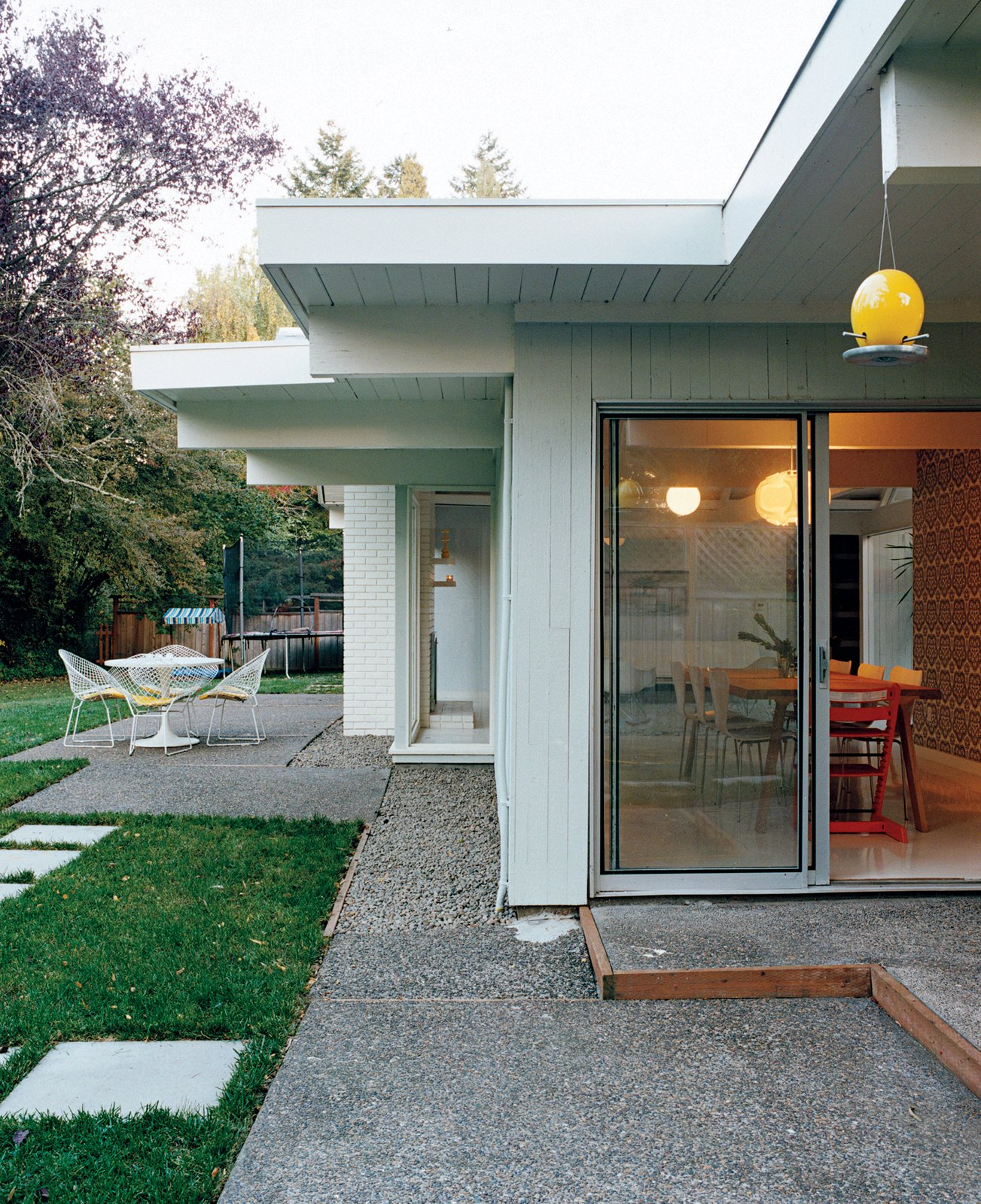 A Dokstra table from Ikea is situated on the patio.  Midcentury Homes by Dwell from A Mid-Century Modern Home in Southwest Portland