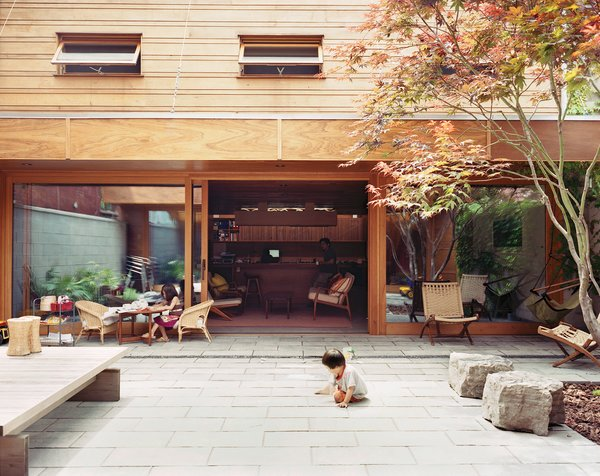Four-year-old Ian plays in the courtyard, which is the center of family life in warmer months.