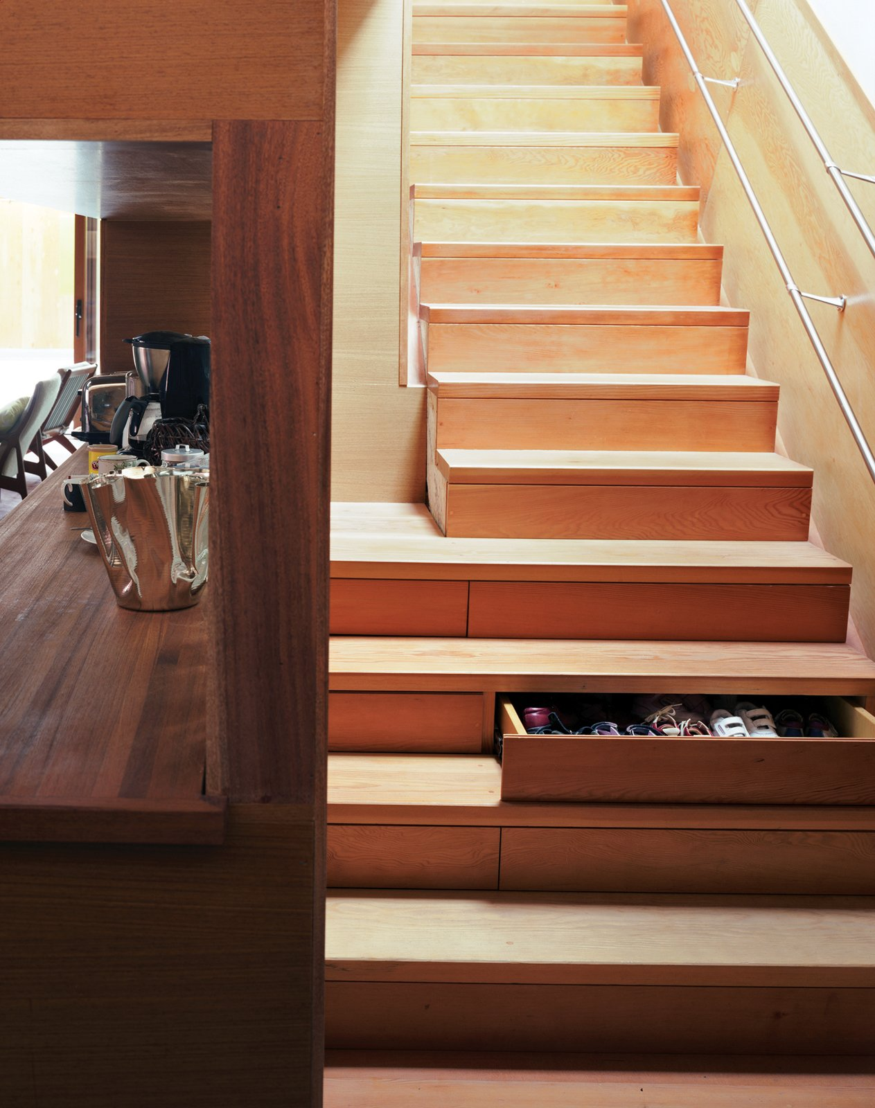 Tan built storage into every available corner of the house, including the stairs, each of which contains a drawer.
