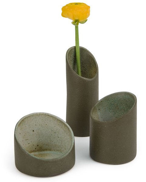 "These cylindrical nesting vases are inspired by the shape of bamboo. Though made from ceramic, the surfaces have a roughness that evokes forests or jungles. They come as a set of three and can be stacked and used as a single vase, or separated and arranged as a trio. Made by hand in Brazil. 5 ½"" h x 3 1/3"" diam. $80.00"