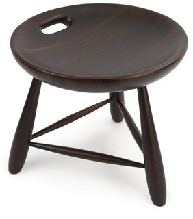 "This was one of my favorite pieces in the collection—eye-catching for its simplicity and the pleasing shape of the seat. The stool, made from Brazilian Eucalyptus, is inspired by the traditional milkmaid's stool used throughout Brazil, with three legs and a single-lathed hollow seat. The handle is a functional detail but it also makes for a beautiful visual embellishment. 15 ¾"" h x 17 ¾"" diam.  $550.00"