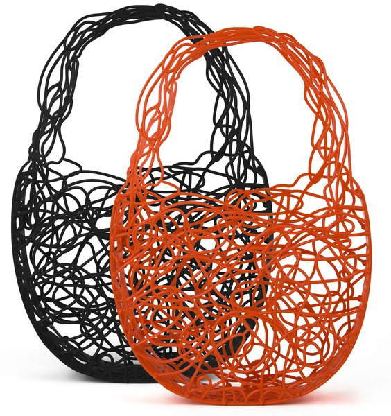 "For those who love the Corallo Chair but can't undertake the commitment (or the shipping), the Campana brothers developed this bag in partnership with rising Brazilian shoe star, Melissa. Made from plastic in Brazil, it's an easily giftable small item for those who don't mind showing off their loot. 18""h x 11""w x 21/2""d. $80"