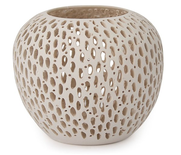 "These intricately detailed oval-shaped candleholders are made by hand from Brazilian white clay. When a tea light is lit inside, the openings in the surface of the candleholder cast patterns and shadows on the wall round it. MoMA Exclusive. Small Oval: 2 ½"" h x 3 ½"" diam., $45 Small Vase: 3 ½"" h x 1 1/3"" diam. $48 Large Oval: 3 ½"" h x 4"" diam. $65"