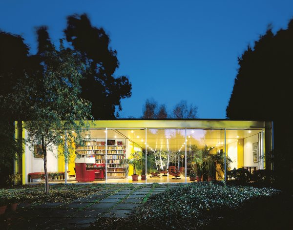 "The Rogers House, built in 1969 for Rogers's parents,was ""a transparent, flexible tube which would be adapted and extended,"" offering freedom of layout through flexibility of design."