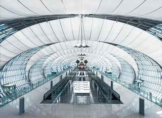 Werner Sobek - Photo 6 of 22 - Suvarnabhumi International Airport, Bangkok, Thailand. From the main building the gates are reached via concourses, consisting of a system of flattened tubes.