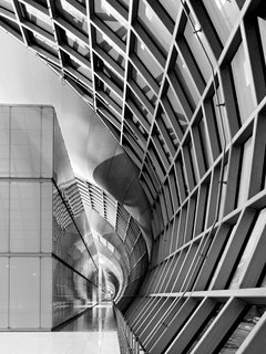 Werner Sobek - Photo 20 of 22 - A concave surface inside one concourse of Suvarnabhumi International Airport is juxstaposed with a continuous vertical surface.