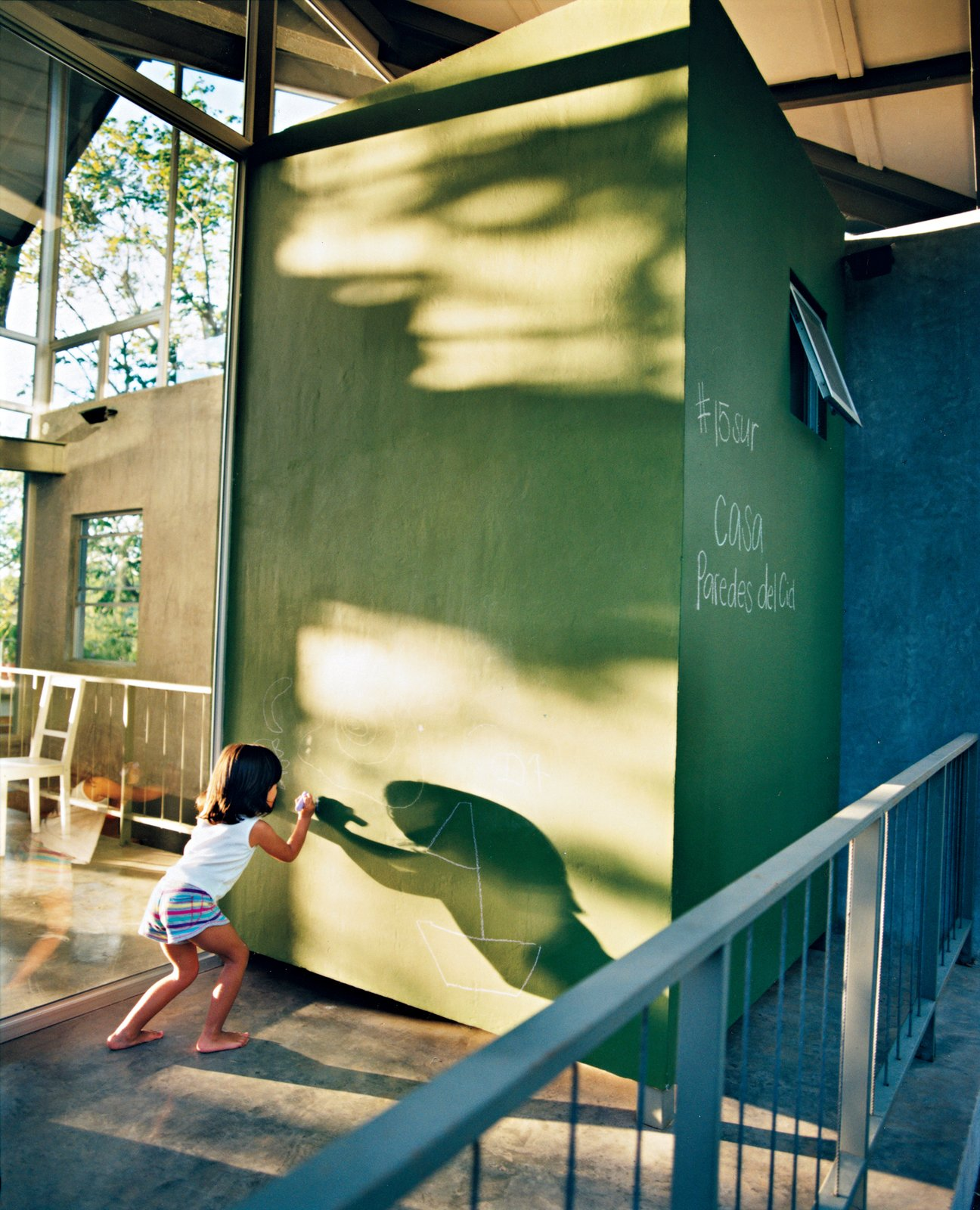 Jimena makes use of a giant chalkboard just outside. Tagged: Kids Room and Playroom.  Photo 7 of 8 in Welcome to the Jungle