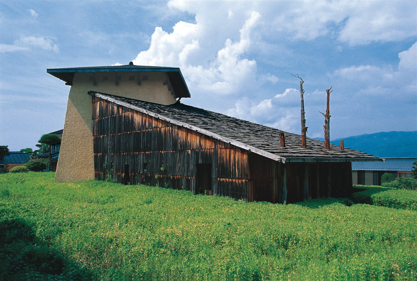 The 1991 Jinchokan Moriya Historical Museum, Fujimori's first commissioned building, signaled the themes that continue to drive his work: design in harmony with nature; raw, natural materials (wood, mud-and-mortar walls); and a Neolithic-inspired architectural style.  Photo 3 of 23 in Terunobu Fujimori