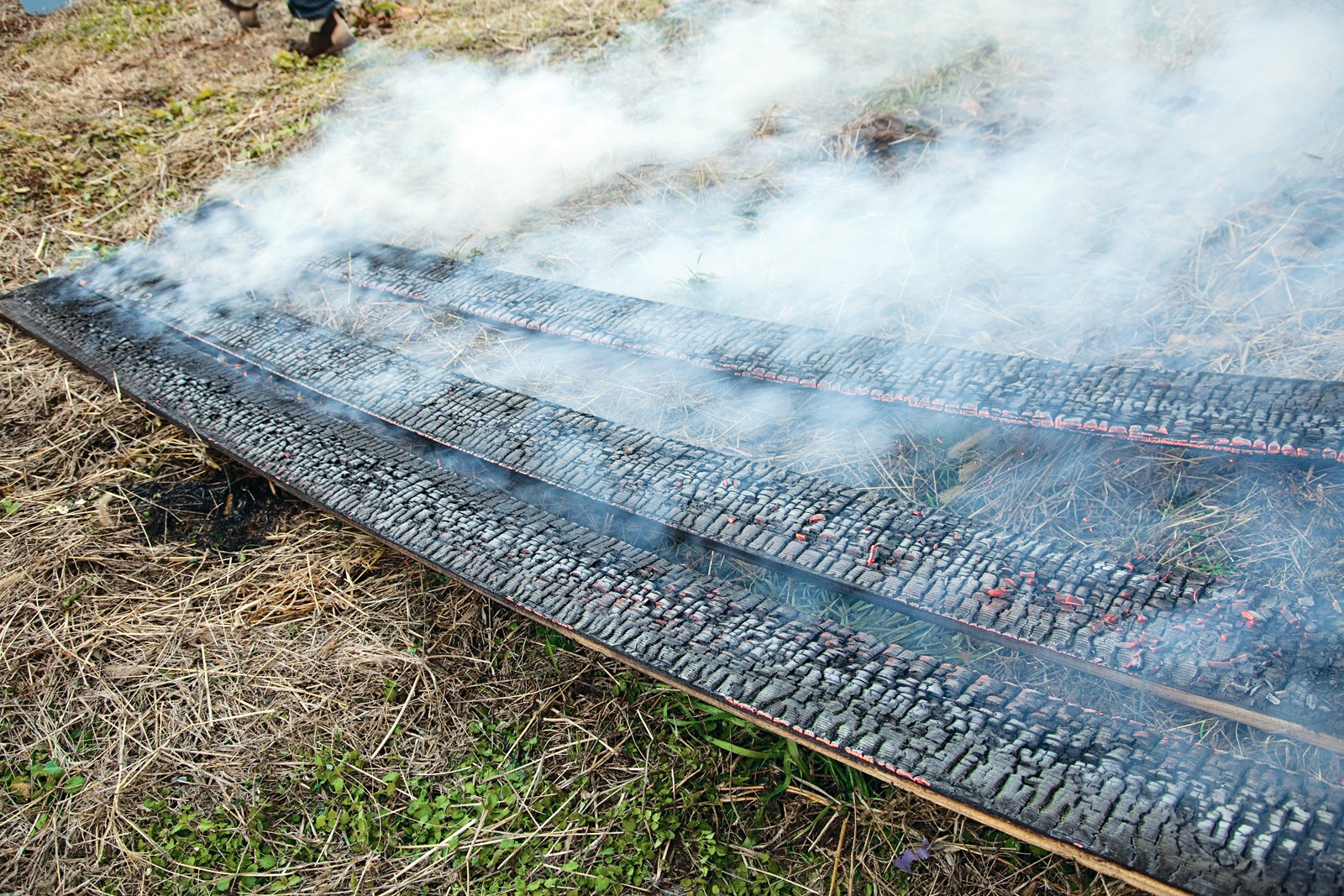 After the flames have been put out, the boards continue to crackle and smoke. Charring the boards properly requires a delicate balance between just enough burning, but not too much.