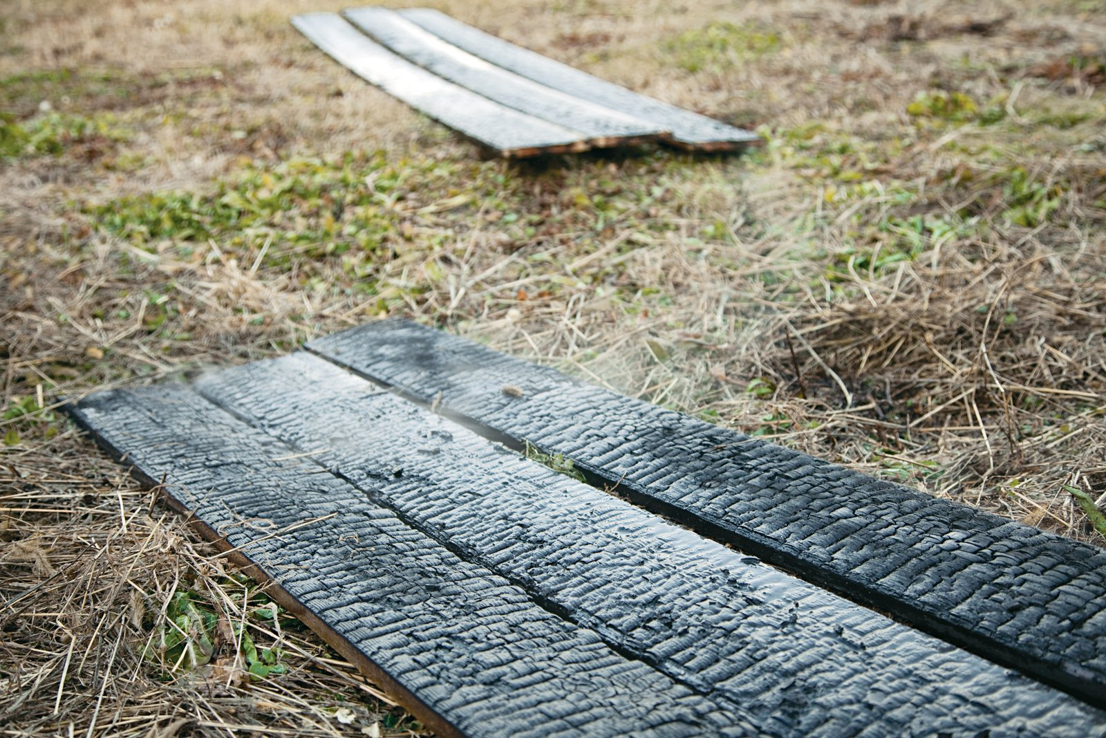 The primitive and painstaking process is said to protect wood against rain, rot, and insects for 80 years. It also gives the exteriors a reptilian texture that's as striking as it is practical.