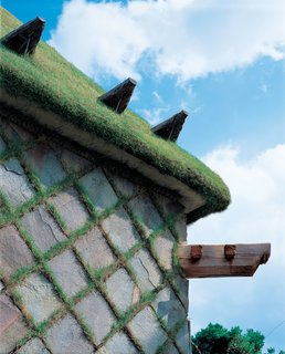 Terunobu Fujimori - Photo 22 of 23 - For Camellia Castle, which houses a sake brewery, Fujimori designed a grass-covered roof and a cladding comprised of grass-and-stone checkerboard.