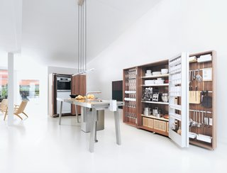 An Introduction to Kitchen Design - Photo 2 of 7 - The Bulthaup b2 brings the woodshop into the kitchen with utilitarian workspaces and pristine, orderly wooden cabinet systems.