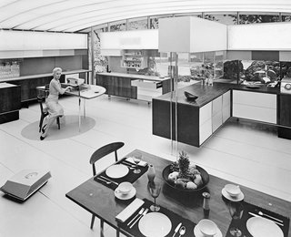 "An Introduction to Kitchen Design - Photo 6 of 7 - A display from the American National Exhibition in Moscow, 1959, depicting a woman in the ""Miracle Kitchen,"" where automation has reduced her domestic workload."