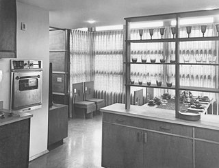 An Introduction to Kitchen Design - Photo 3 of 7 - Interior of a prefab house showing kitchen looking out into dining room, designed by Frank Lloyd Wright.