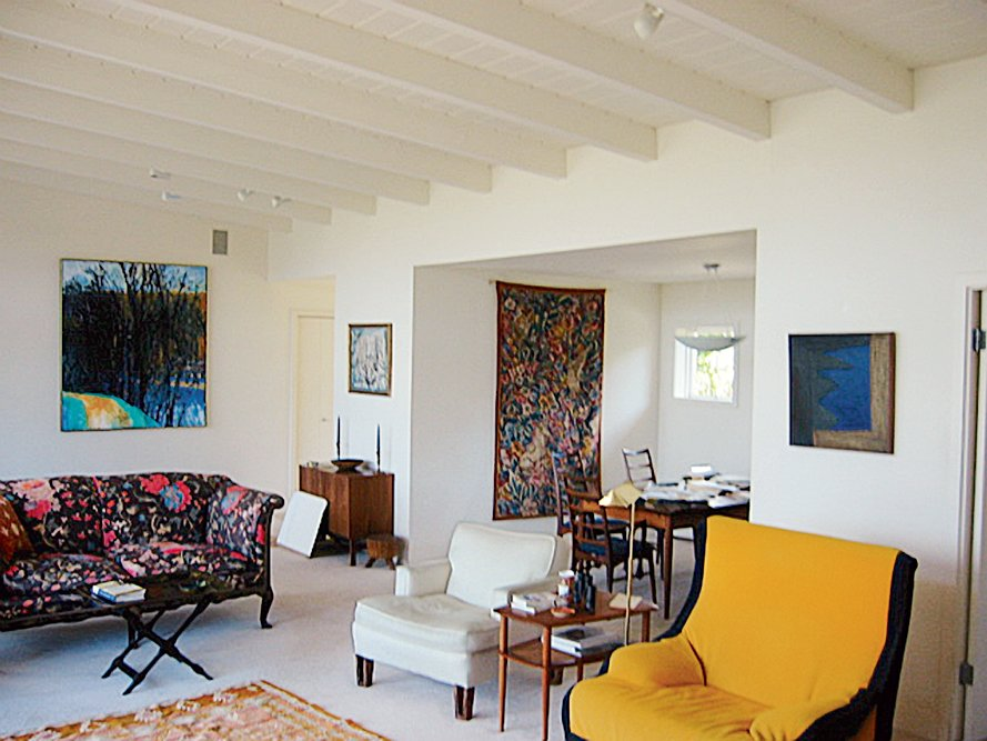 The Harris family chose to balance the clean white walls and ceiling of their family room with furniture in eclectic and exciting colors.  Photo 2 of 10 in The Bellwether of Belvedere