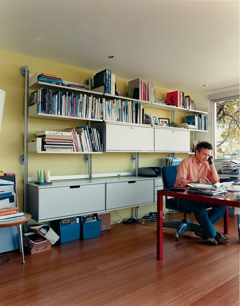 What was once a boat room now serves as a home office. The engineered bamboo floors are from Eco Timber. The modular shelving and storage systems are by Vitsoe.