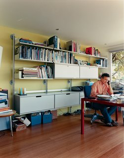 The Bellwether of Belvedere - Photo 5 of 10 - What was once a boat room now serves as a home office. The engineered bamboo floors are from Eco Timber. The modular shelving and storage systems are by Vitsoe.