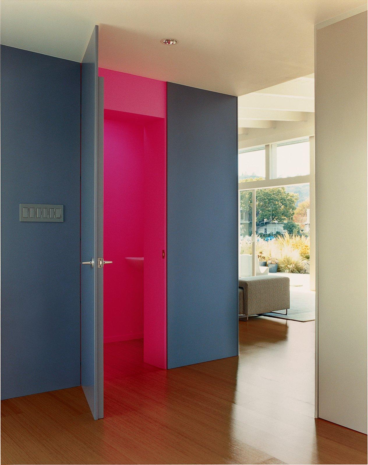 In the foyer, Deam left one surprise: The neon-pink guest bathroom is hidden behind heavy, dark-gray walls. Best Photos