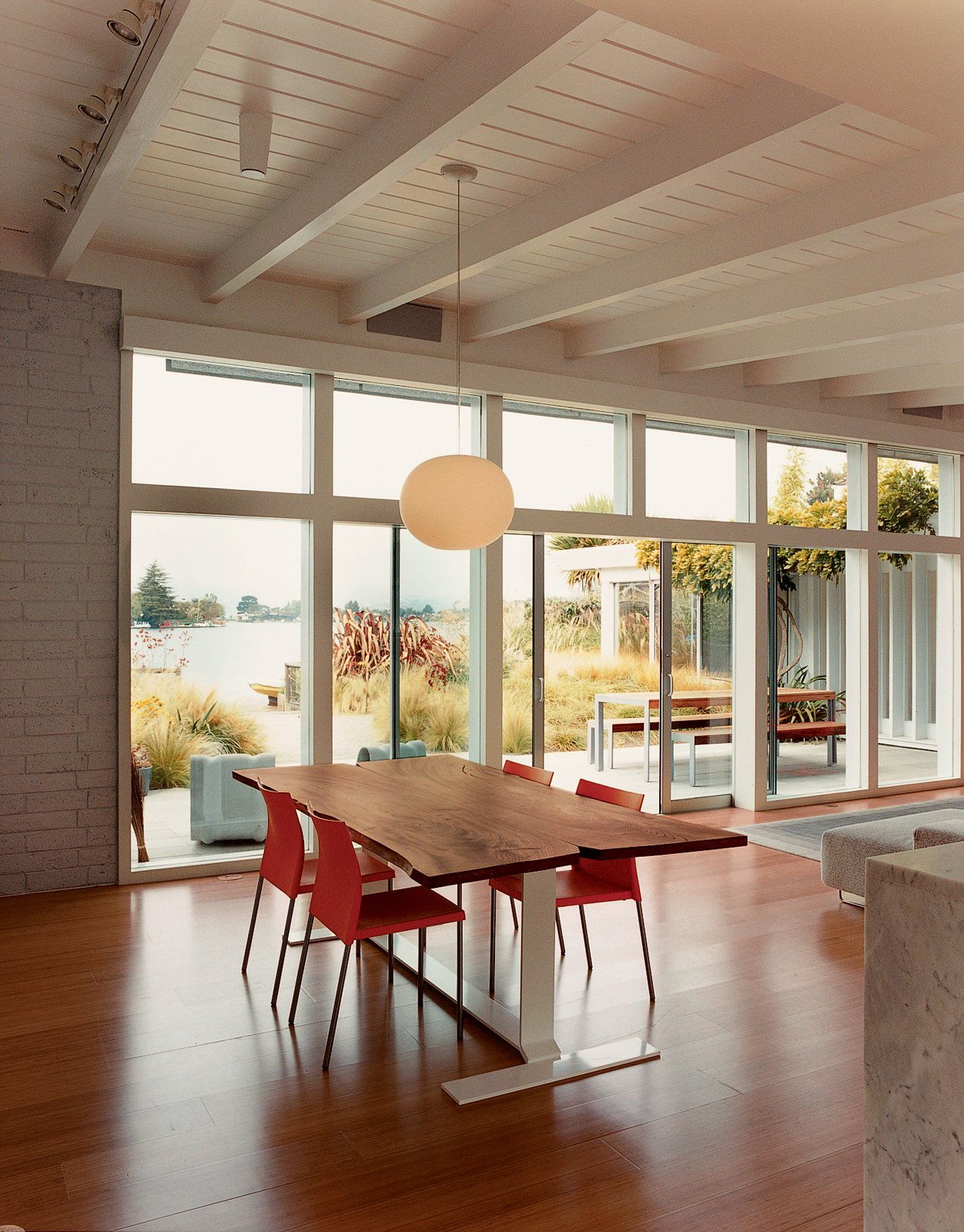 Architect Deam created the dining table from a fallen elm tree.  Photo 8 of 10 in The Bellwether of Belvedere