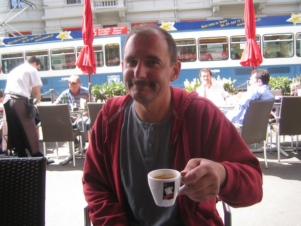 Architect Felix Oesch enjoying an espresso at the Cafe Odeon across the street from Lake Zurich.
