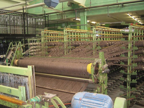 One of the massive weaving machines at Ruckstuhl, where up to 3600 spools of thread are needed for each rug.