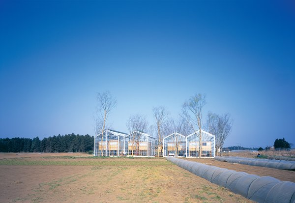 Sitting placidly in the midst of open farmland (as evidenced by the gray plastic crop covers that seem to run into the greenhouses), Millennium City is an experiment by Japanese architect Hiroshi Iguchi in utopian sustainable living.