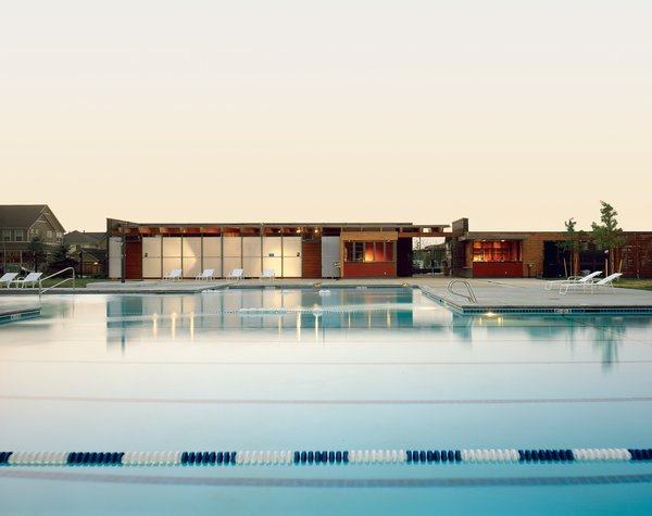 This public pool house was designed to merge with its park surroundings. Translucent wall materials, floating overhead planes, and plenty of windows let the light in.<br><br>Project: Stapleton Neighborhood Pool House<br><br>Architect: Semple Brown Design<br><br>Location: Denver, Colorado
