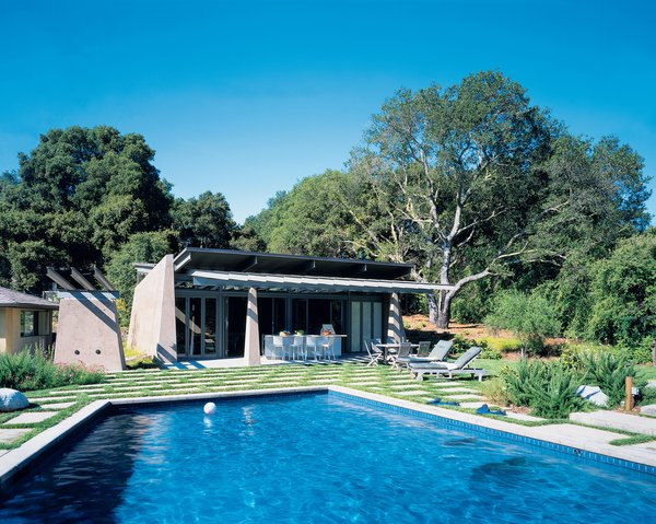 Colored concrete walls, pivoting glass doors, and a scissor-shaped steel roof maintain the fun and modern feel of this computer-game designer's suburban poolside shelter.<br><br>Project: Traeger Pool House<br><br>Architect: Dan Phipps Architects<br><br>Location: Woodside, California