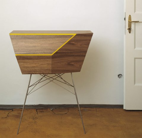 MAREK GUT COMMODE  We couldn't help spotlighting this retrofuturistic piece of furniture by Polish designer Marek Gut. The so-called Commode (we'd probably associate a different kind of object with such a name, but in this case it's something of sideboard) is a practical storage chest that capitalizes on its design-driven angles by containing shelves of various sizes and shapes.  Modern Entry Way Accessories by Megan Hamaker from Marek Gut Commode