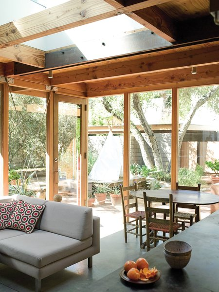 Separated only by large expanses of glass, the interior and exterior landscape flow together.