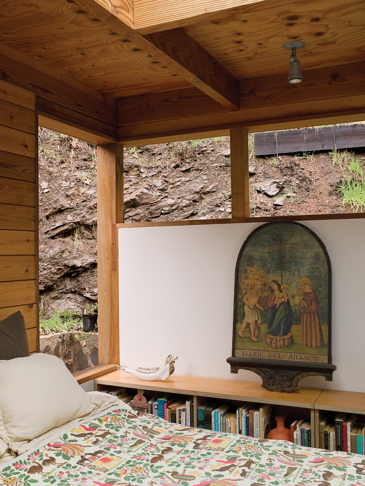 From their bedroom, Hadley and Peter can gaze out at the canyon wall or up through a skylight at the clouds and stars. Tagged: Bedroom and Bed.  Photo 4 of 12 in Compound Addition