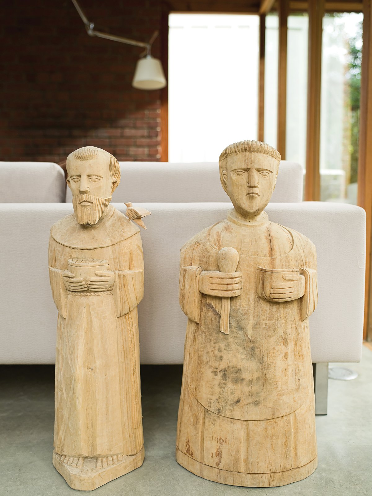 The Arnolds consider Francis and Paschal the patron saints of their home, representing moderation or austerity tempered by generous hospitality.  Photo 11 of 12 in Compound Addition