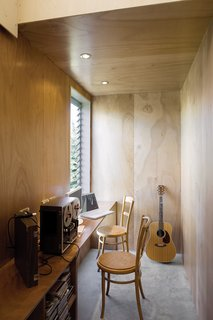 The study is narrow but illuminated by a window, louvered like others in the house to help regulate heat.