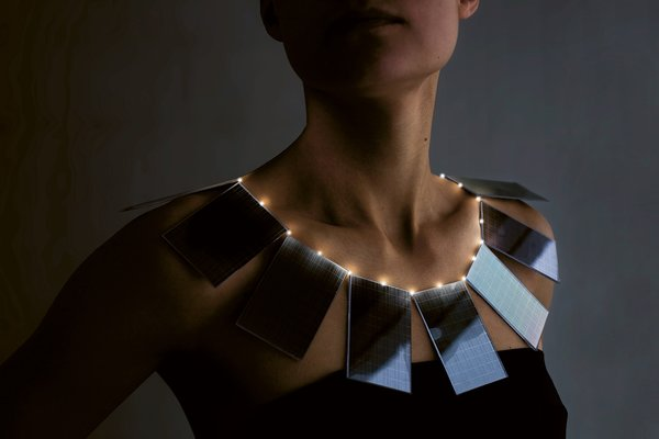 Lux necklace by Mae Yokoyama<br><br>Mae Yokoyama's necklace combines haute couture and high technology to highlight the benefits of solar energy. During the day, the solar panels create a bold collar necklace. At night, the energy accumulated during the daytime illuminates small lights to create the effect of a string of pearls, Yokoyama writes about her design.<br><br>Photo by Andreas Nyquist