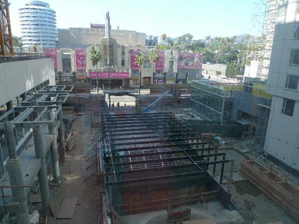 A view of the W Ciné plaza from the third floor. The Hollywood/Vine Metro station is being renovated under black steel girders.