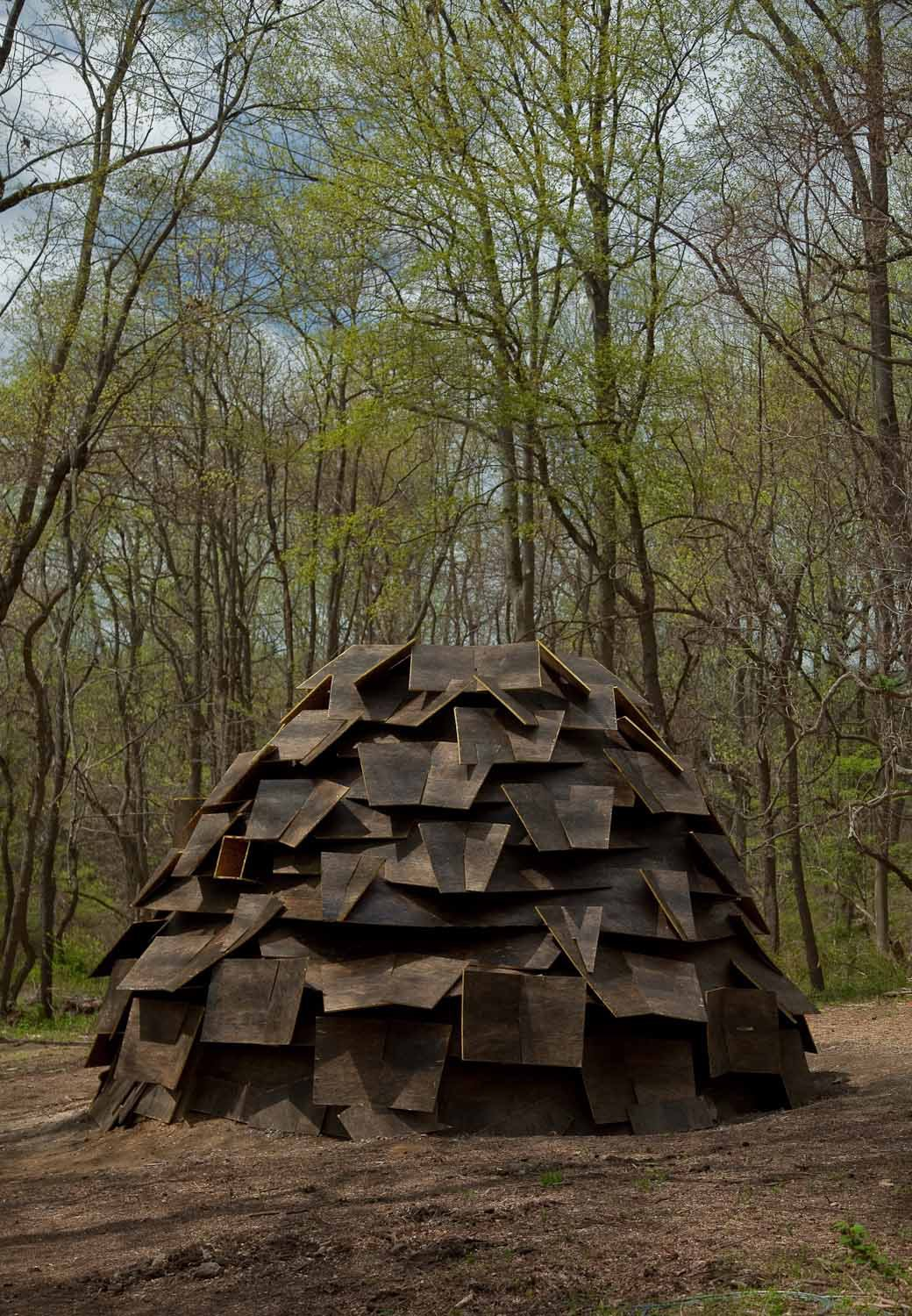 Rain Shelter by GCArchitects, Gabriela Sanz Rodriguez and Carlos Martinez Mediero  Constructed from recycled wood, the rain shelter provides as much solice as entertainment: It becomes a fountain in the rain, a prism of light in the sun, and a whistle in the wind.  Photo by Jack Ramsdale. Courtesy of  the Schuylkill Center for Environmental Education.