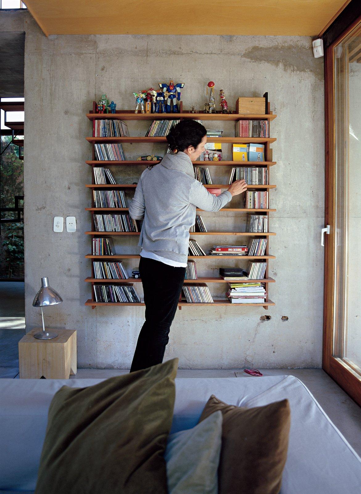 Hernaez organizes CDs on a modular lapacho wood shelf designed by Sticotti. Storage by Dwell