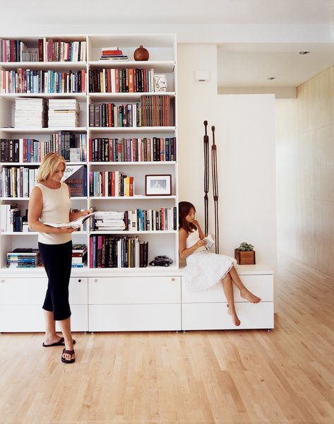 The main living room, separated by a freestanding wall, continues into an open study. The bookshelves, close to ten feet tall, are home to numerous architectural books, philosophy texts, and the literary work of Ayn Rand. Recessed speakers emanate music throughout, dependant on the wills of Jespersens' iPod.