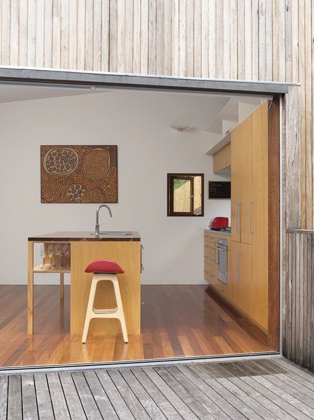 Pedigree Charted - Photo 2 of 10 - A painting by Aboriginal artist Yinarupa Gibson Nangala hangs in the kitchen, with a barstool from Danish designer Erik Buch in the foreground.