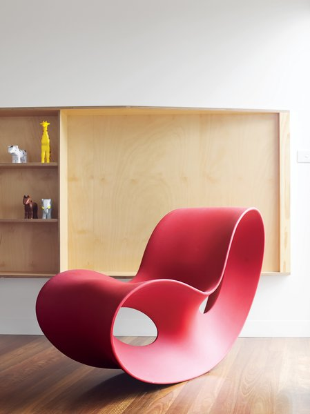 Pedigree Charted - Photo 6 of 10 - Ferguson's prized Voido rocking chair is positioned by a living-room window that affords views of the small town and its beach. Designed in 2002 by Ron Arad for Magis, the Voido is blow-molded entirely from polyethylene.