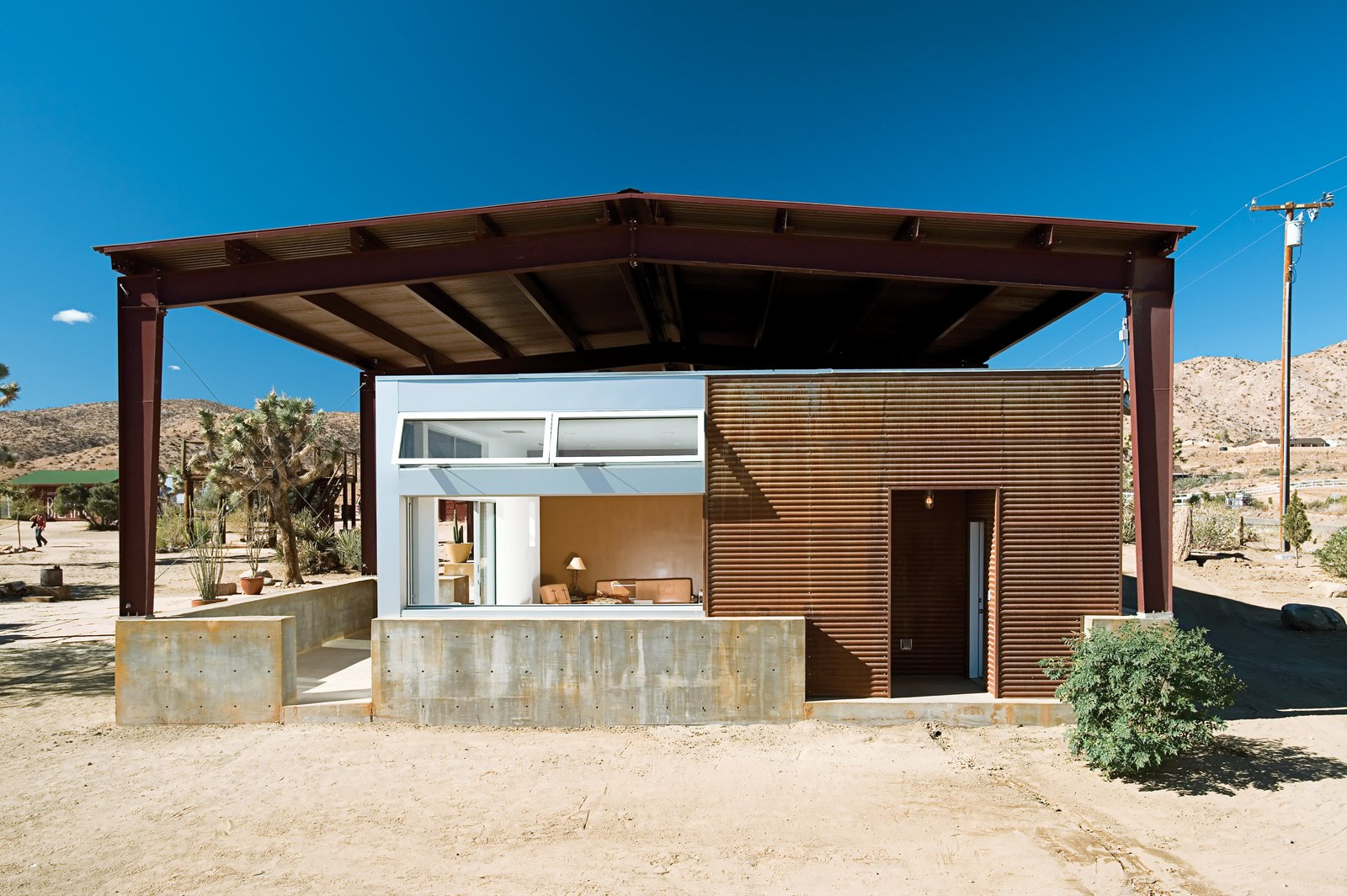 The rustic look of surfwear entrepreneur Jim Austin's home both stands out and also conforms with its rough-and-tumble surroundings in Pioneertown, California. Tagged: Shed & Studio and Living Space.  Photo 1 of 3 in Operation Desert Shed