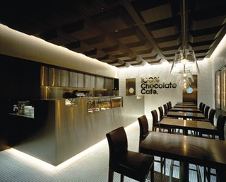 At the 100% Chocolate Café the traditional shape of chocolate bars suspended from above creates the witty reverse relief of a classically coffered ceiling.