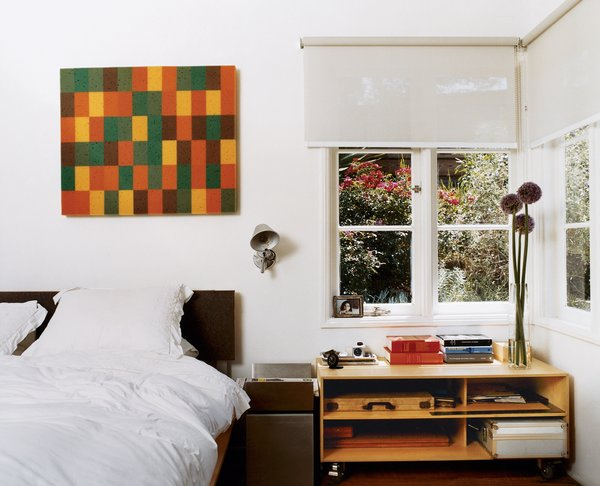 Day designed the plywood-and-aluminum platform bed in the master bedroom, which also opens onto a shady private terrace. The painting is by An Te Liu.