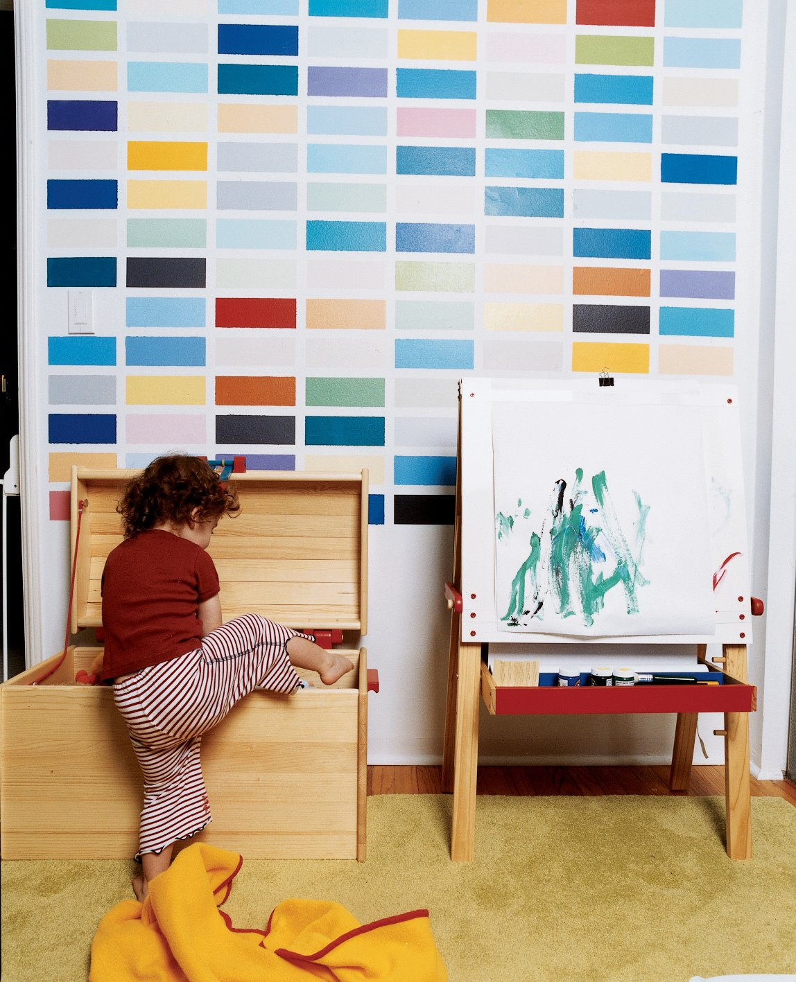 Sosi gets into trouble beneath a colorful grid painted by her dad as a riff on the German painter Gerhard Richter.  Photo 10 of 12 in Way Out West